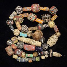 ROMAN ANCIENT BEAD NECKLACE, 3rd century BC-1st millennium AD. The necklace with 53 ancient mostly mosaic glass beads, most Roman a few a little later. Necklace 31 inches, longest bead is Phoenician 2.2 inches. Nice selection of better mosaic glass beads.