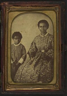 [Full-length portrait of an unidentified woman, seated, and full-length portrait of a child standing on her right, both subjects are facing front]; 1860-1870, carte de vista