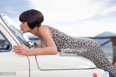Stock Photo : Woman kissing a car