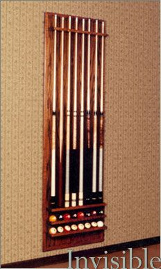 A Hidden Safe Discretely Concealed Behind A Pool Cue Rack