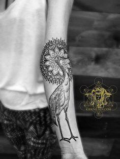Mandala and bird tattoo on the left arm, by Kirk Edward Nilsen II.