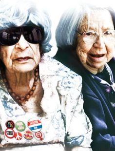 """Two elderly women with glasses: the woman on the left wears large  sunglasses and a series of politically themed buttons on her blouse, some of which read """"Vote"""" and """"Strike"""" and """"Peace."""" Sunset Hall """"They're old, they'e bold and they'll change the way you think about aging."""""""