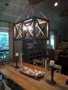 Our XX Chandelier wood light fixture with Edison bulbs and crisscross designs…