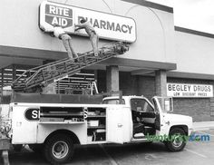 Red McDaniel and Paul Fletcher, employees of Smithers Sign Co., put up a new Rite Aid Pharmacy sign April 28, 1988 on the former Begley drugstore in Imperial Shopping Center on Waller Avenue in Lexington. Rite Aid, at the time the nation's largest drugstore company, bought Begley's for $18.5 million in 1988.Photo by Michael Malone | staff