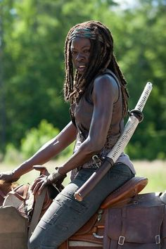 Michonne...of course she had to come riding in on a horse in Episode 1!! Bad Ass defined. ..