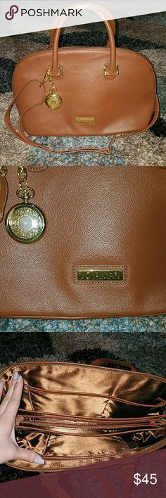 """Bag Brand new bag! Includes crossbody strap and small handles. •Brand is Joy and Iman •Inside is in perfect condition! •Dimensions: 9"""" Deep and 13"""" Wide •Many pockets •Can fit an iPad/tablet •Has a pocket watch included (needs a new battery) Joy & Iman Bags Crossbody Bags"""