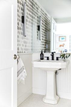 tiny bathroom design ideas: full-size mirror, wallpaper, wainscoting, floor tiles