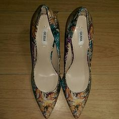 Guess Plasmas Floral Pumps New, never worn, leather pumps with all-over multi-colored floral print and a 4 inch stiletto heel. Guess Shoes Heels