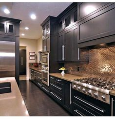 Mirrored or stainless steel backsplash tiles