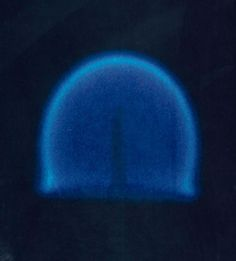 Can a Candle Burn in Zero Gravity?: This photograph shows a candle flame burning in microgravity. The flame expands outward and produces very little soot.