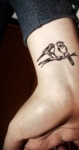 Small wrist two magpie tattoo