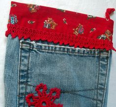 A fun Christmas stocking made from an old pair of jeans. This one is decorated with lace and snowflakes that I crocheted myself. It measures 20 X 10.5 inches.
