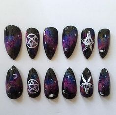 Black stiletto nails with galaxy, pentagram, and goat design