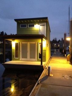 """500 sq.ft. houseboat built """"green"""" and painted green.  This owner downsized from a Victorian to this.  Look at interior pics...beautiful!  See builder info on other pin."""