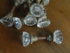 This listing is for one set (two knobs and a spindle) of vintage glass doorknobs. They are the classic 12 point style and are in very good