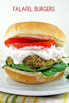 Veggie burgers packed with all the Mediterranean flavors of falafel and smothered in a chunky feta tzatziki sauce.