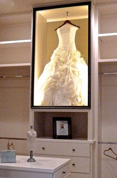 Wedding dress display case in the master closet. Beautiful idea created by designers from Houston's ASID showcase Wedding Dress Shadow Box, Wedding Dress Display, Wedding Dress Frame, Bouquet Shadow Box, Wedding Dress Storage, Closet Bedroom, Master Closet, Vanity In Closet, Closet Space