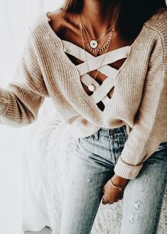 Cute laced front top with blue denim jeans.