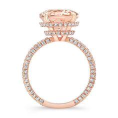 This stunning morganite and diamond engagement ring will sweep her off her feet. Bright and beautiful center stone is cradled in a double invisible halo. Delicate rose gold shank encrusted with diamonds. Beautiful oval cut morganite grasped with claw prongs. Unique & breathtaking. Center Stone: Morganite Weight: 3.50 ct Color: Peachy pink Clarity: VS Shape: Oval Side Stones: Diamonds Weight: 0.60 ct Color: G Clarity: VS-SI Shape: Round