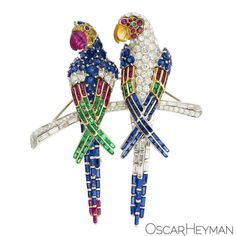 @oscarheyman. Just love these parrots. Each can be worn separately or together on the branch. #OscarHeyman @by_couture