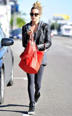 Ashley Tisdale adds some edge to her patterned leggings with a studded leather moto jacket.... - Celebrity Street Style