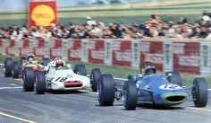 F2 1969 , Reims, France. Pedro Rodriguez (Matra), Jo Siffert (BMW) and the winner of the day,François Cevert (Tecno).
