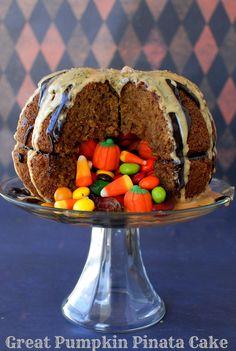 Great Pumpkin Pinata Cake. A great surprise when cutting into a spice cake pumpkin! - BoulderLocavore.com #halloween #fall #recipe