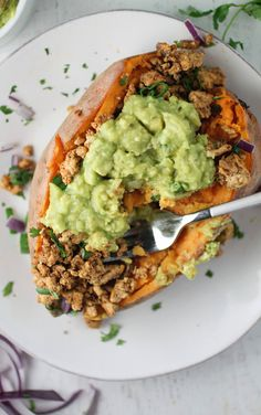 Taco Stuffed Sweet Potato - sweet potatoes, olive oil, onion, garlic cloves, ground turkey, garlic powder, onion powder, dried oregano, black pepper, chili powder, paprika, sea salt, cumin, water, scallion, fresh cilantro, guacamole (can make by hand with avocado, lime juice, garlic, sea salt, & pepper)