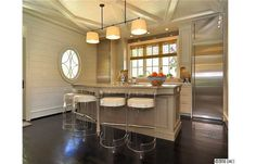 Gorgeous kitchen, wicked fridge, awesome color scheme, great bar stools! Love it all.