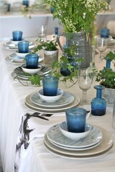 Large glass pitcher centerpiece with wild flowers