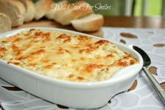 Absolutely incredible Hot Crab Dip! It's made with crab meat, cream cheese, lots of other cheese and baked to perfection!