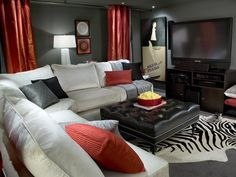 Small Space Media Room Candice Olson transforms a small basement space into a movie theater. Dark gray walls are perfect for movie night. The white sectional, red accents and ample lighting keep the space from feeling dark and drab.