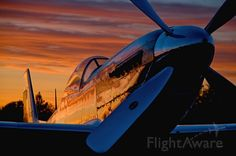Sunset reflects on highly polished P-51 Mustang