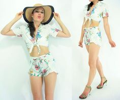 2 piece crop blouse and shorts set:  -White with Hawaiian floral print  -Crop blouse with tie front closure and fold over collar  -High waist wrap