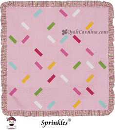 """Rainbow """"sprinkles"""" and a ruffle sewn into the binding make The Little General's project for 2013 cute as can be! 52"""" x 52"""" quilt."""