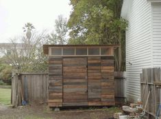 cool shed/studio made from reclaimed timber fence