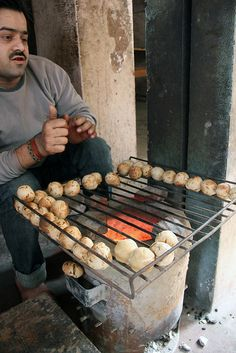 Street Food: The baati chokha vendor in Varanasi, India.  Baati is a hard, unleavened bread cooked in the desert areas of Rajasthan, and in Uttar Pradesh and Madhya Pradesh. It is prized for its long shelf life and high nutritional content, and, in desert areas, for the minimal quantity of water required for its preparation.