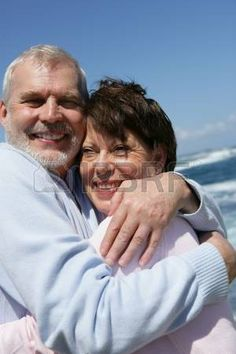 Mature couple on the beach photo