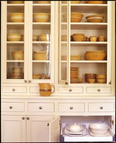 Install these upper cabinets over existing lower cabinets, also for dish storage. I wish I had this collection of yellow ware! Glass Front Cabinets, Upper Cabinets, Cupboards, Kitchen Cabinets, China Cabinets, Kitchen Organization, Kitchen Storage, Dish Storage, Organized Kitchen