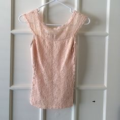 Express blush colored lace top I bought this to wear under a grey suit and wore it once before I decided I wanted something different. It's beautiful blush lace paneled on the front with a v in the back. Rounded neck line. Express Tops