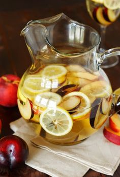 White Sangria with Nectarines, Plums, & Lemons ~ perfect for summer sipping.    www.thekitchenismyplayground.com