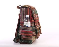 This backpack is made from tribal striped woven backpack with fully lined interior, It has adjustable straps and closes with magnetic closures. Perfect size for carry your text books, shoes, snacks, tablet and anything that fits into the bag. This is naturally stylish getup for your beautiful lightweight day out!  ► 100% Cotton ► Eco friendly ► Lightweight ► Fully Lined with black cotton fabric ► Magnetic closures ► Adjustable comfy shoulder straps ► 5 pocket (1 Big Pocket, 1 front, each…