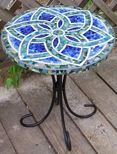 Table top...I wrote a story about a gal who made these mosaic table tops as a vocation. Love 'em.