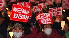 Thousands of people rally in Seoul, seeking the resignation of South Korean President Park Geun-hye.