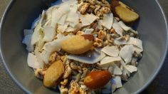 Mixed cereals, Brazil nuts and shredded coconut with rice milk.
