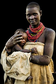 Africa | Young Karo woman with her baby. Omo Valley, Ethiopia