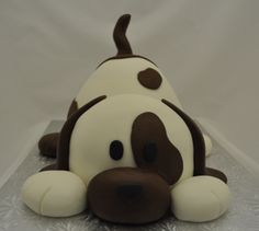 Poky Little Puppy - This cake is a combination of the Debbie Brown puppy from her new book and The Poky Little Puppy which was my favorite book growing up.  All I knew is I wanted a white and brown dog but only realized half way through that the image in my head was that book from my childhood :)  Love this cake (I hope I can upload additional pics) have not been able to on the last 4 cakes I uploaded! ARGH!