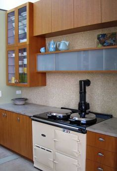 aga cooker  Cabinets too: could approx with/Ikea by combining Besta and Akurum. Not sure Besta could handle weight of kitchen loads tho.
