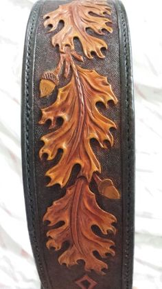 Hand tooled leather guitar strap with oak leaves and acorns.