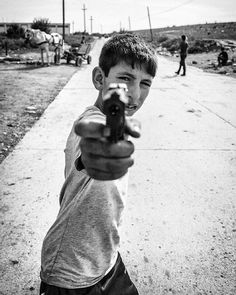 Roma boy with gun by Joost Vandebrug Tumblr, Fine Art, Couple Photos, Gun, People, Poster, Photography, Fictional Characters, Image